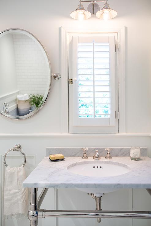 Bathroom Window Dressed In Plantation Shutters Over Vanity