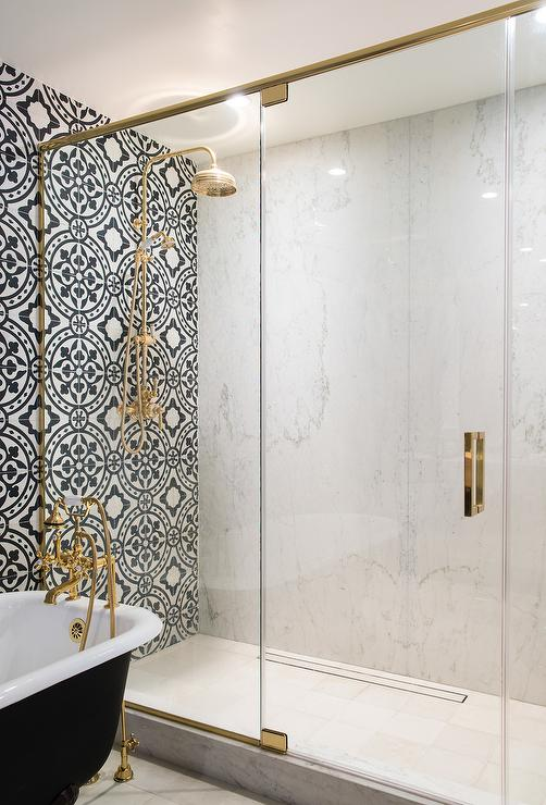 White And Black Bathroom Features An Accent Wall Clad In Black And White  Cement Tiles, Cement Tile Shop Bristol Tiles, Lined With A Black Clawfoot  Tub ...