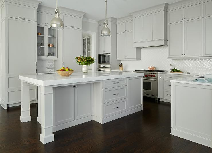 Light Gray Painted Kitchen Cabinets With Glossy White Chevron Tiles - Light gray painted kitchen cabinets