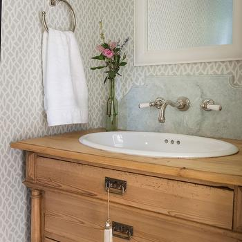 Powder Room With Gold Quatrefoil Mirror And Dresser Turned