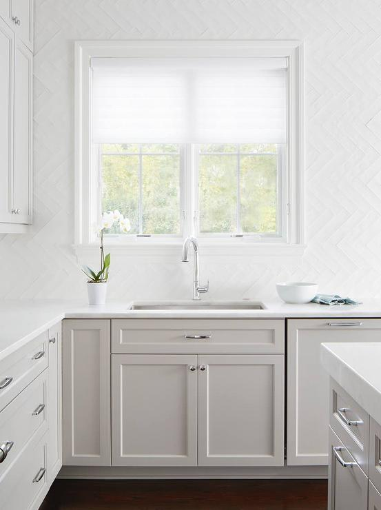 Pale gray shaker cabinets with glossy white glass for Shiny white kitchen cabinets