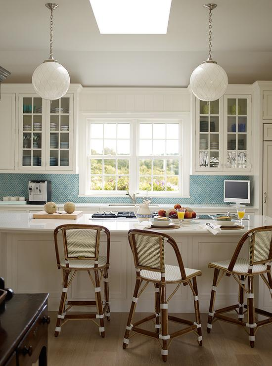 White Kitchen With Blue Herringbone Backsplash Tiles