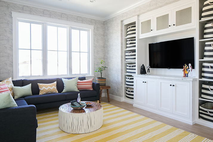 Family Room And Playroom With Inset Shelves Filled With