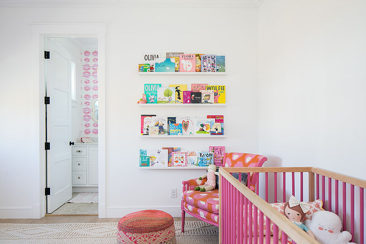 pink nursery with pink spindle crib