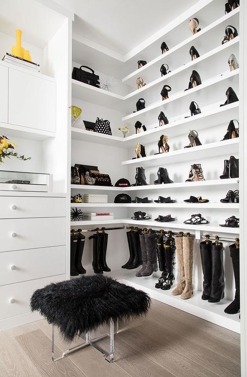 Walk In Closet With Wraparound Shoe Shelves And Hanging Boot Hooks
