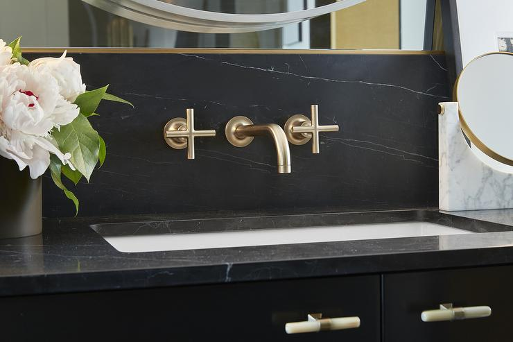 Black And Gold Bathroom With Soapstone Countertops And Backsplash