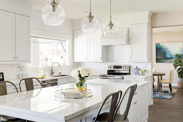White Kitchen with White Beveled Tiles and Tolix Bar Stools ...