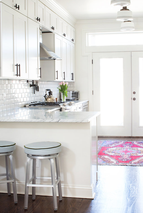 White And Gray Kitchen With Pink Rug And Crate And Barrel
