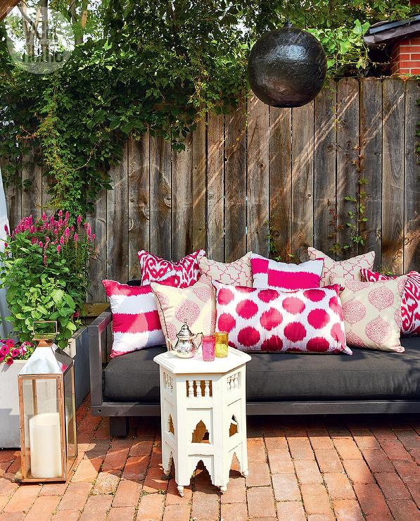 Outdoor Moroccan Decor Design Ideas: Contemporary Deck With Black Outdoor Sofa And Pink Pillows