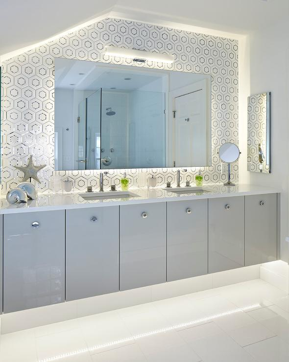 gray lacquered floating bath vanity cabinets with his and hers sinks