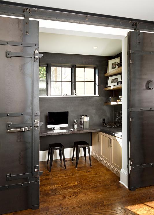 Industrial home office with metal barn doors on rails for Barn doors for home office