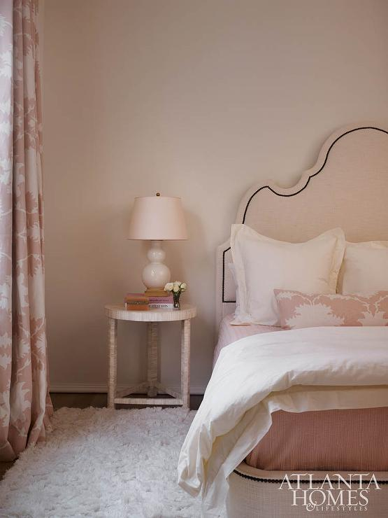 Pale Pink Walls Frame A Stunning Light Pink Nailhead Headboard Bed Dressed  In Pink Bedding, An Ivory Duvet, Ivory Shams, And Mary McDonald Garden Of  Persia ...