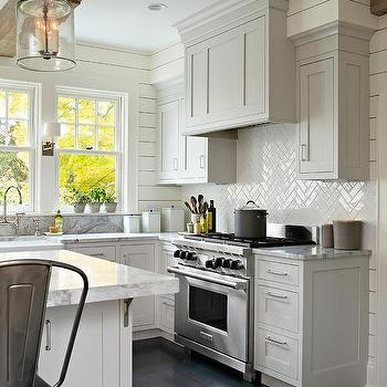 Gray galley style kitchen with gray and white quartzite for Shiny white kitchen cabinets