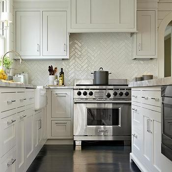 Gray Shaker Kitchen Cabinets With Dark Stained Wood Floors And White  Chevron Tiles Photo