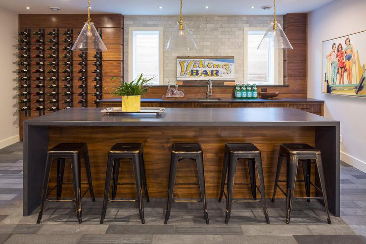 Amazing Basement Bar Features Stained Wood Cabinets Paired With Charcoal  Gray Quartz Countertops Fitted With A Square Bar Sink And Gooseneck Faucet  Placed ...