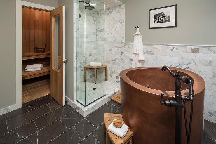 Chic Country Bathroom Features A Freestanding Round Copper Bathtub With An  Oil Rubbed Bronze Vintage Tub Filler As Well As A Curved Teak Step Stool  Placed ...
