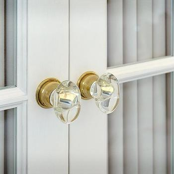 White pantry doors with brass and glass door knobs for French door knobs