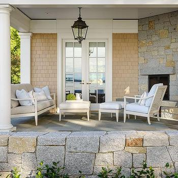 Covered Patio With Greek Columns And Corner Fireplace
