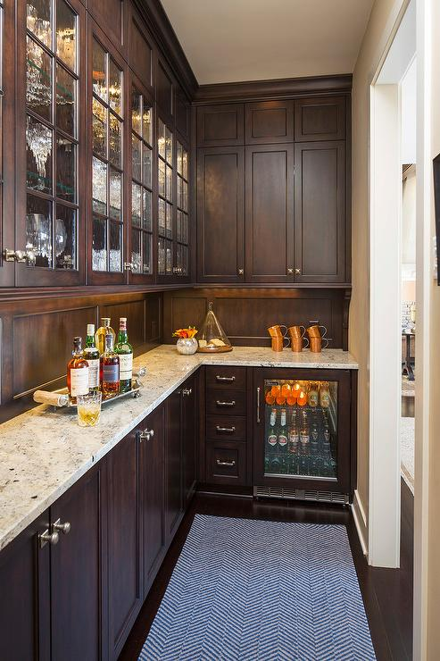 Brown Pantry Cabinets With Crema Persa Granite Countertops