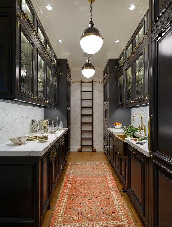 Black galley kitchen with gold accents transitional for Black and white galley kitchen