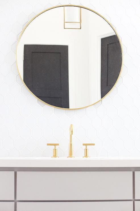 Gray Bath Vanity With Extra Large Round Brass Mirror