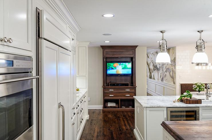 Gourmet kitchen with tv cabinet with pocket doors transitional kitchen - Retractable kitchen cabinet doors ...