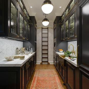 Black Galley Kitchen With Gold Accents