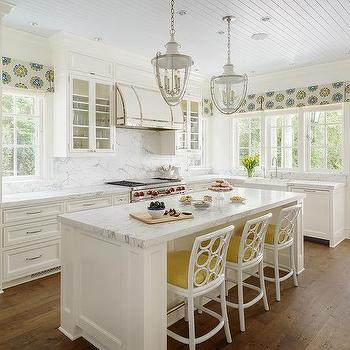 White And Yellow Kitchen With White Rattan Counter Stools