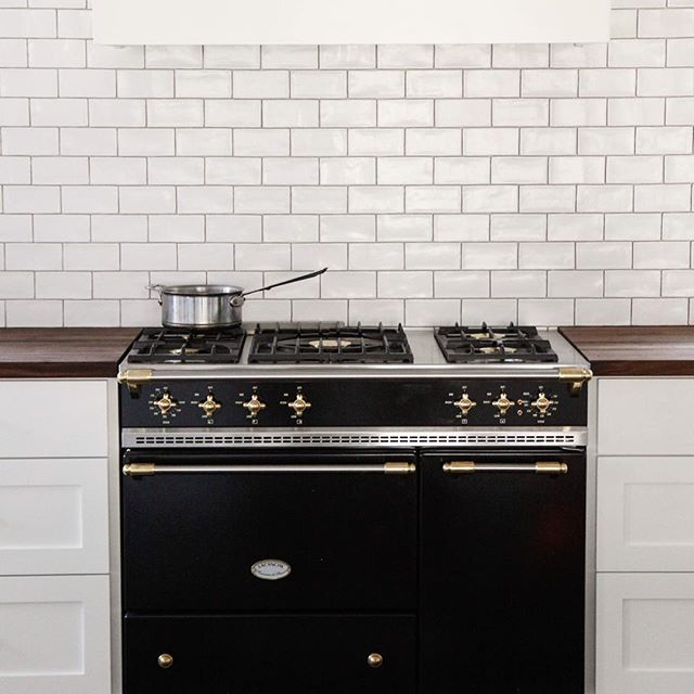 Black Countertop Stove : black french stove range flanked by white shaker cabinets topped ...