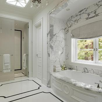 Pacific Peninsula Group Marble Bathroom Nook With Wainscoted Bathtub And Skylight