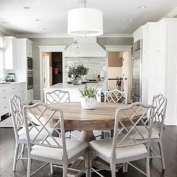 Round Gray Wood Dining Table With Bamboo Chairs And White Drum Pendant