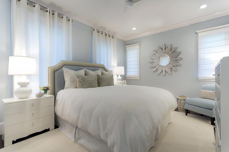 White And Blue Bedroom With Silver Sunburst Mirror