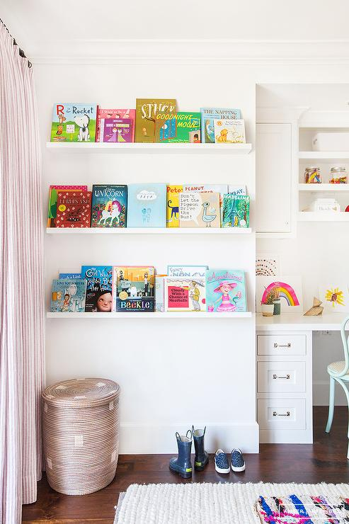 Adorably Designed Kids Room Showcases Books On Land Of Nod Straight U0026  Narrow Book Ledges Positioned Above A Woven Basket Placed Next To A Window  Covered In ...
