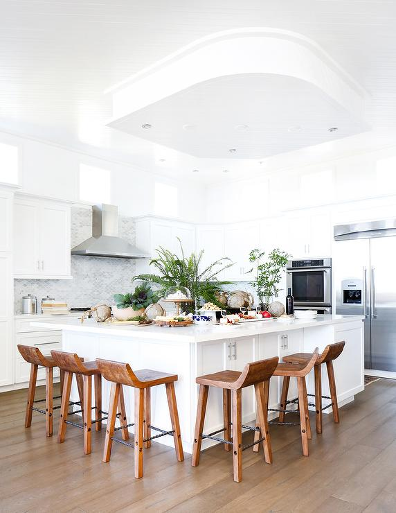 White Kitchen With Caramel Stained Wood Floors