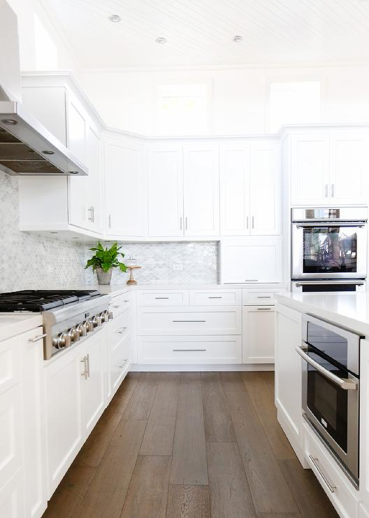 White Kitchen With Caramel Stained Wood Floors Transitional