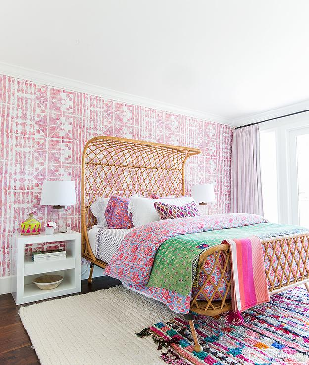 Rattan Bed With Pink Wallpaper On Bedroom Accent Wall