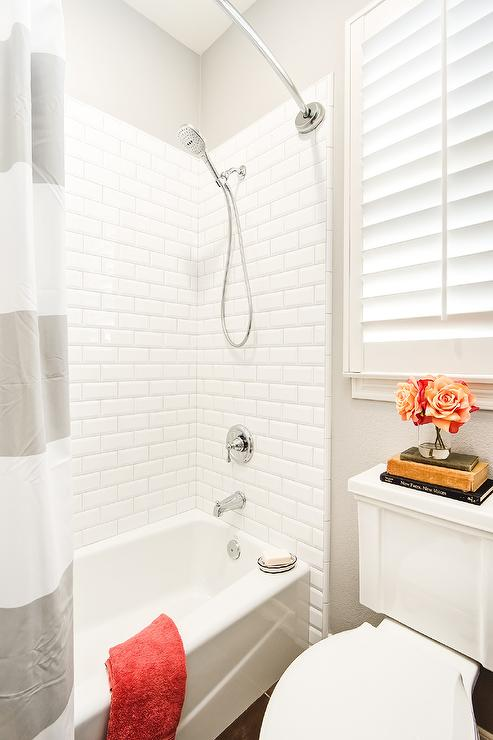 Nice Kids Shower With White Beveled Subway Tiles And Gray Striped Shower Curtain