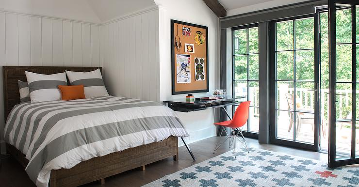 beautifully design kidsu0027 room showcases a beautiful white vertical shiplap wall positioned behind a stunning salvaged wood bed dressed in white