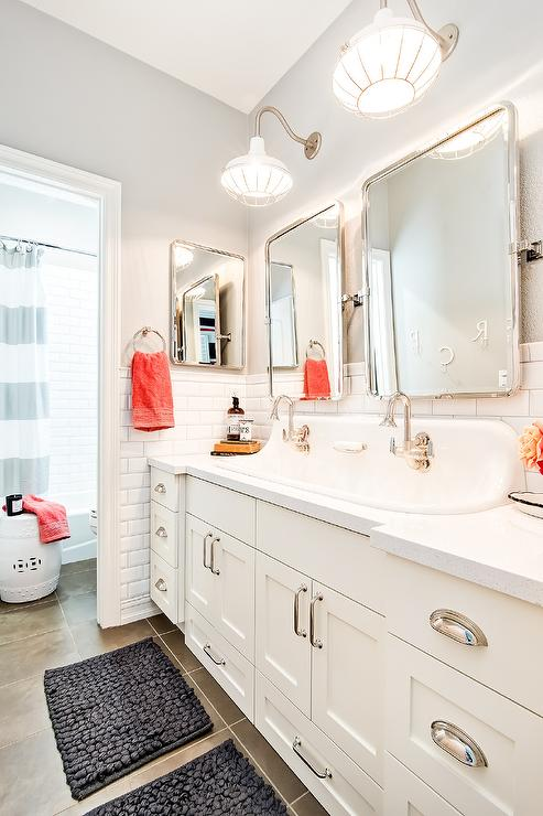 well appointed shared boysu0027 cottage bathroom boasts a beautiful white double washstand sat against a white beveled subway tiled backsplash fitted with