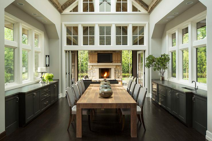 View Full Size Stunningly Dramatic Dining Room Features An Oak Table With