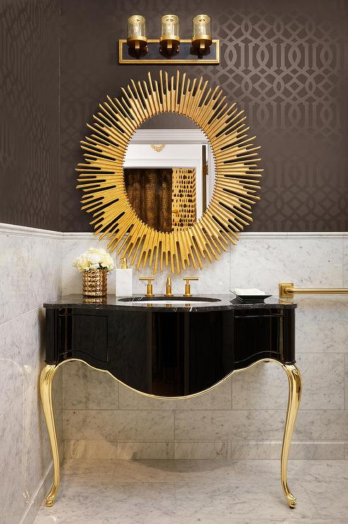 Black and gold powder room with gold oval sunburst mirror for Black and gold bathroom ideas