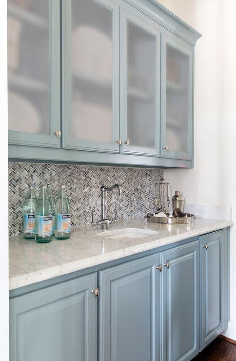Blue Bar Features Frosted Glass Upper Cabinets And Blue Lower Cabinets  Paired With White Marble Countertops Fitted With A Curved Sink And Vintage  Faucet As ...