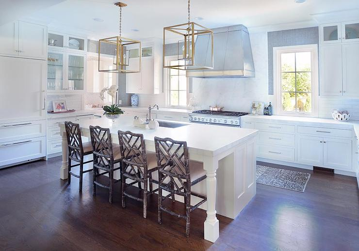 White Kitchen Island With Brown Bamboo Dining Chairs And Square Brass Lanterns