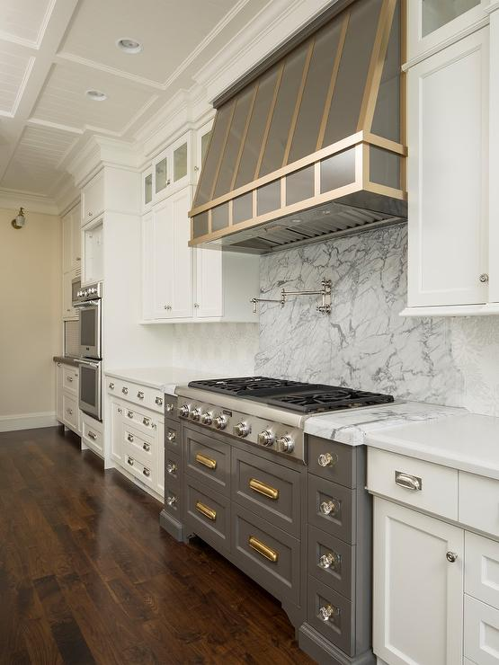 Gray Cooktop Drawers With Shiny Brass Vintage Pulls