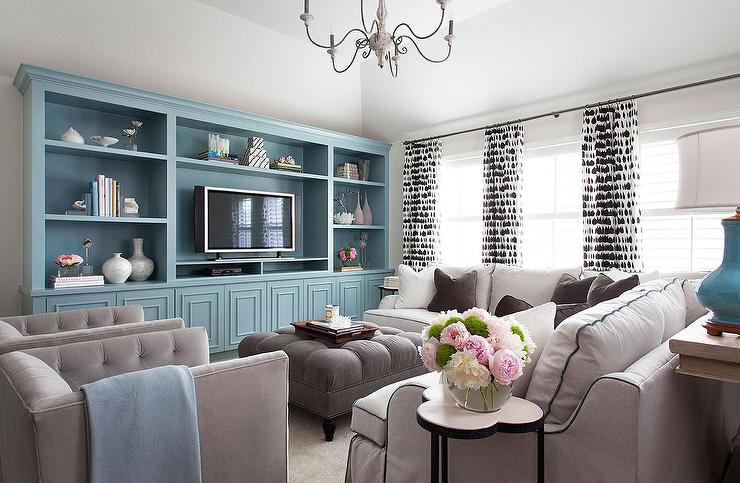 White And Gray Living Room Features A Sofa Table Topped With Turquoise Blue  Lamps Placed Behind A White Roll Arm Sectional Sofa With Blue Piping  Accented ...