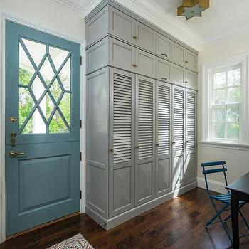 gray louvered mudroom cabinets with brass star shaped flush mount light