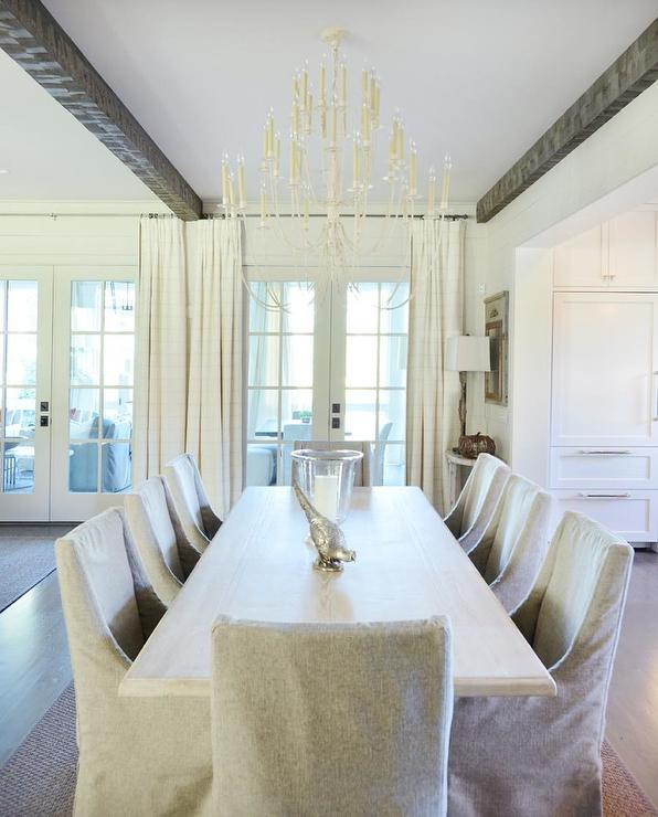 Monochromatic Dining Room With Tiered Chandelier