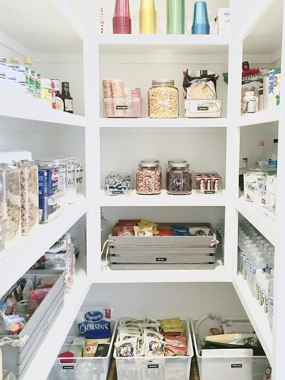 U Shaped Pantry With Labeled Snack Jars And Gray Snack