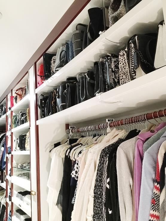 walk in closet with stacked purse shelves transitional closet. Black Bedroom Furniture Sets. Home Design Ideas