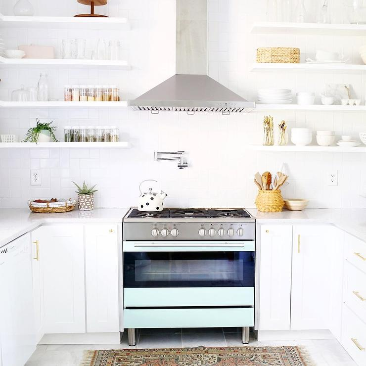 White Kitchen Floating Shelves: White Kitchen With Blue Stove And Floating Shelves